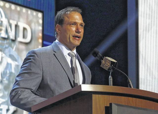FILE - In this May 1, 2015, file photo, Chris Spielman speaks at the 2015 NFL Football Draft, in Chicago. One of Ohio State's most famous football stars sued the university Friday, July 14, 2017, over a marketing program he says used athletes' images without permission and robbed them of compensation. Linebacker Chris Spielman filed the antitrust lawsuit in federal court in Columbus on behalf of current and former Ohio State football players. The complaint targets Ohio State marketing programs and contracts that promote the university using likenesses of athletes, including a Honda-sponsored program of 64 banners hung around Ohio Stadium featuring photos of former players.