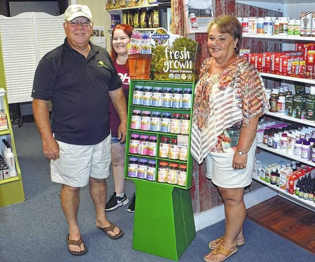 Steve Hedrick, Lexi Ritchie and Diane Hedrick offer a wide variety of items at Elida Health Foods.