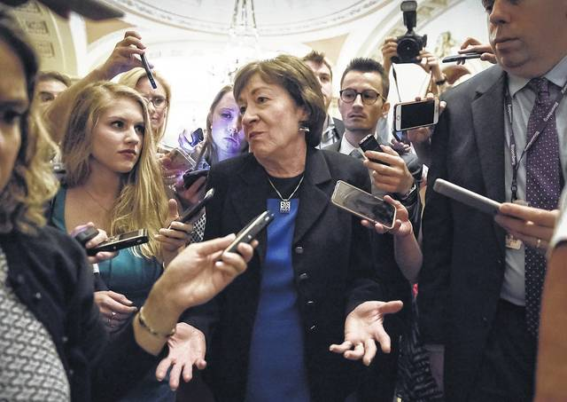 Sen. Susan Collins, R-Maine is surrounded by reporters on Capitol Hill in Washington, Thursday, July 13, 2017, after a revised version of the Republican health care bill was announced by Senate Majority Leader Mitch McConnell of Ky. The bill has faced opposition and challenges within the Republican ranks, including by Sen. Collins.