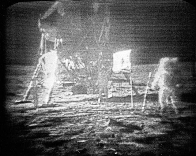 FILE - In this July 20, 1969 file photo, Apollo 11 astronaut Neil Armstrong, right, trudges across the surface of the moon leaving behind footprints. Moon dust collected by Armstrong during the first lunar landing is being sold at a New York auction. The lunar dust plus some tiny rocks that Armstrong also collected are zipped up in a small bag and are worth an estimated $2 million to $4 million. They're just some of the items linked to space travel that Sotheby's is auctioning off to mark the 48th anniversary of the first lunar landing on July 20.