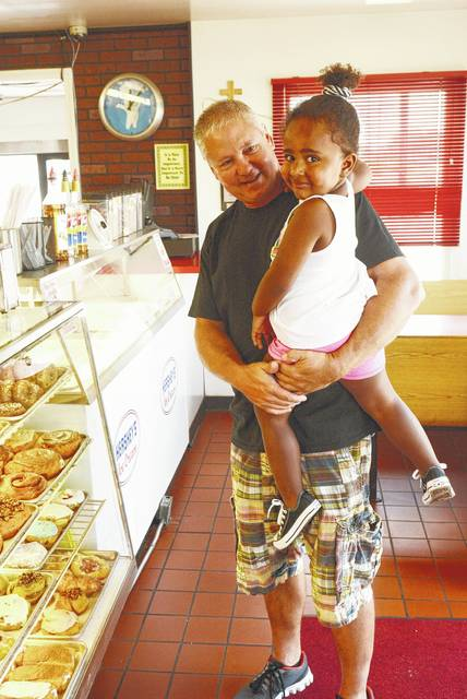 Ralph Ash helps Laelah Ash make a selection on her first experience at Pat's Donuts & Kreme.