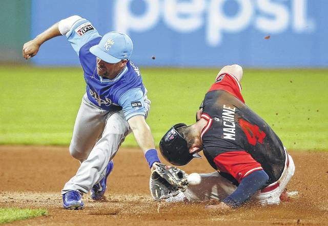 The Indians' Bradley Zimmer (4) steals second base as the ball gets away from Kansas City's Whit Merrifield during Saturday night's game in Cleveland.