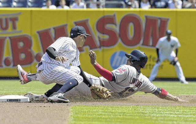 Cleveland's Francisco Lindor slides into second with a stolen base ahead of the tag by the New York Yankees' Ronald Torreyes during the game of a Wednesday doubleheader in New York.