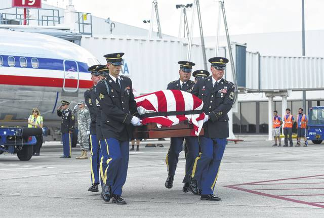 The casket of the late Sgt. Harold Davis arrives at John Glenn Columbus International Airport in Columbus on Thursday. The casket was escorted back to Zanesville, where Davis was laid to rest on Saturday. Davis died in a plane crash during WWII, and his remains were only recently identified.