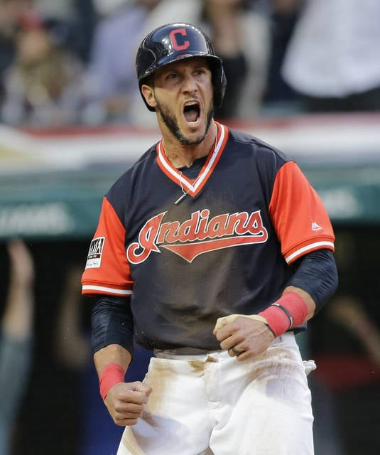 Cleveland Indians' Yan Gomes reacts after scoring against the Kansas City Royals during the third inning of a baseball game, Friday, Aug. 25, 2017, in Cleveland. (AP Photo/Tony Dejak)