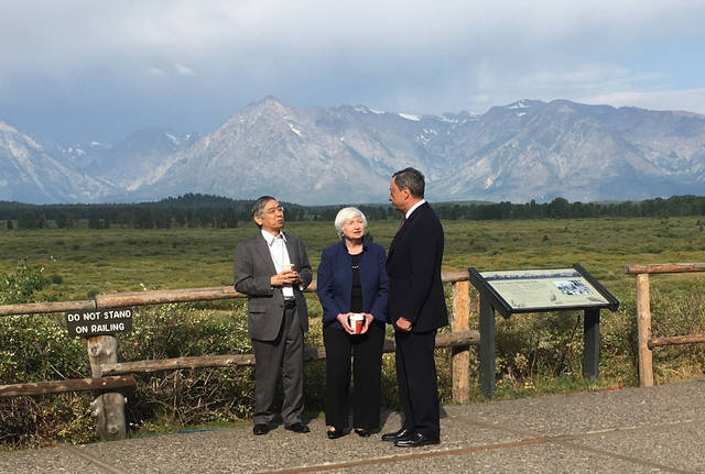 Federal Reserve Chair Janet Yellen, talks with Mario Draghi, head of the European Central Bank, and Haruhiko Kuroda, head of the Bank of Japan, during a break at the central bankers conference at Jackson Hole, Wyo., Friday, Aug. 25, 2017. The conference, in its 41st year, is sponsored by the Federal Reserve Bank of Kansas City.  (AP Photo/Martin Crutsinger)