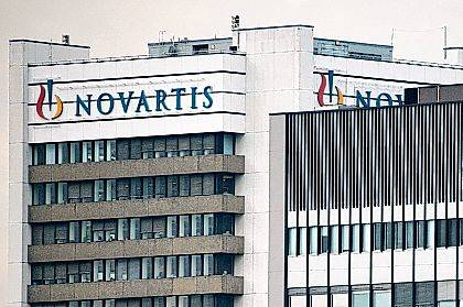 This Oct. 25, 2011, file photo shows the logo of Swiss pharmaceutical company Novartis AG on one of their buildings in Basel, Switzerland. According to results published Sunday for the first time, a drug has helped prevent heart attacks by curbing inflammation, a new and very different approach than lowering cholesterol, which has been the main focus for decades. Canakinumab's maker, Novartis, sponsored the study.