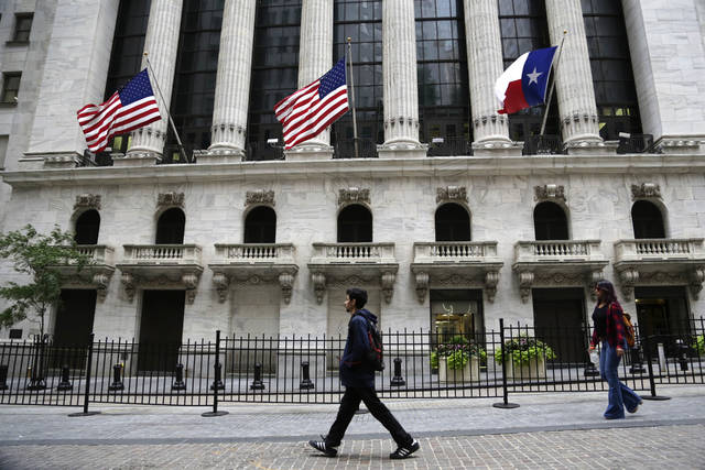 The flag of Texas flies outside the New York Stock Exchange, Tuesday, Aug. 29, 2017, in New York. The exchange has committed more than $1 million for Hurricane Harvey relief efforts. U.S. stocks are following other global market indexes lower Tuesday after investors were shaken up by North Korea's launch of a midrange ballistic missile that crossed over northern Japan and fell into the Pacific Ocean. (AP Photo Peter Morgan)
