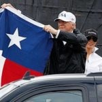 Trump offers flag-waving optimism in visit to Harvey's path