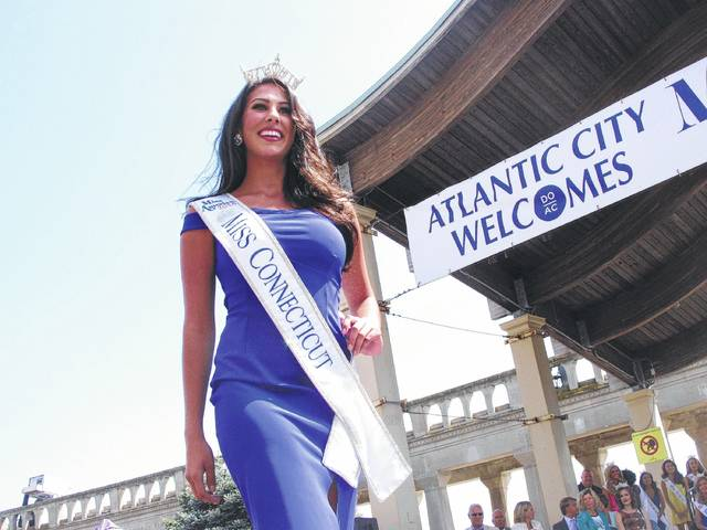 This Aug. 30, 2016 photo shows Miss Connecticut 2016 Alyssa Rae Taglia at a welcoming ceremony for Miss America contestants in Atlantic City, N.J. The welcoming ceremony for this year's field of contestants will be held in Atlantic City on Wednesday, Aug. 30, 2017, and the next Miss America will be crowned on Sept. 10, 2017. (AP Photo/Wayne Parry)