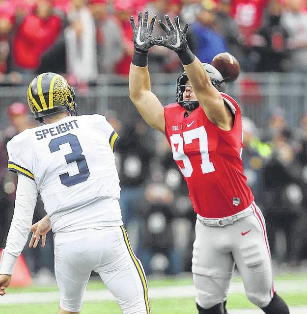 Ohio State #97 Nick Bosa tries to get his hands on a pass from Michigan QB #3 Wilton Seight in the first half at Ohio Stadium on the campus of The Ohio State University School November 26th, 2016 Photo By Don Speck