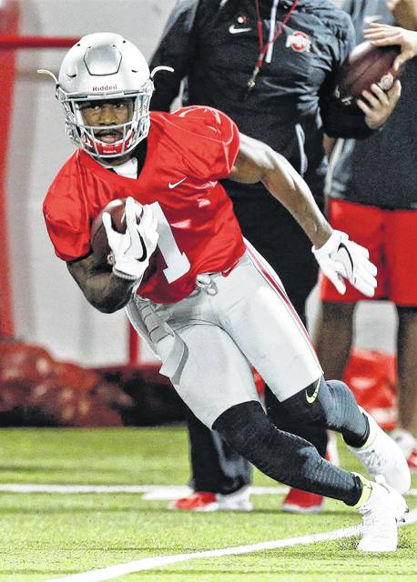 Ohio State wide receiver Johnnie Dixon runs the ball during spring NCAA college football practice in Columbus, Ohio in March. The Buckeyes are hoping one of the half dozen or so unproven but talented wideouts becomes a household name, or at least turns into a reliable deep-ball threat.