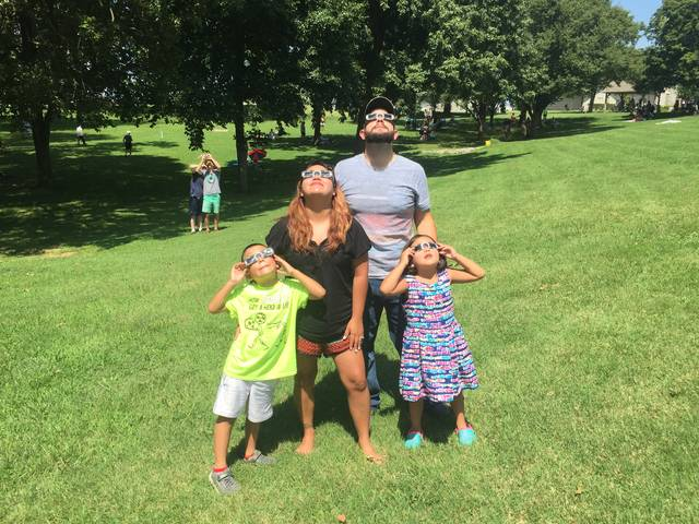 Lizbeth Hernandez , Lima | Submitted photo Lizbeth Hernandez and her husband, Kyle Anderson, traveled with their children, Adrian Anderson, 8, and Alicia Anderson 6, to Mitchellville, Tennessee, to view the eclipse at 100 percent. Share your photos at http://j.mp/limaphotos.