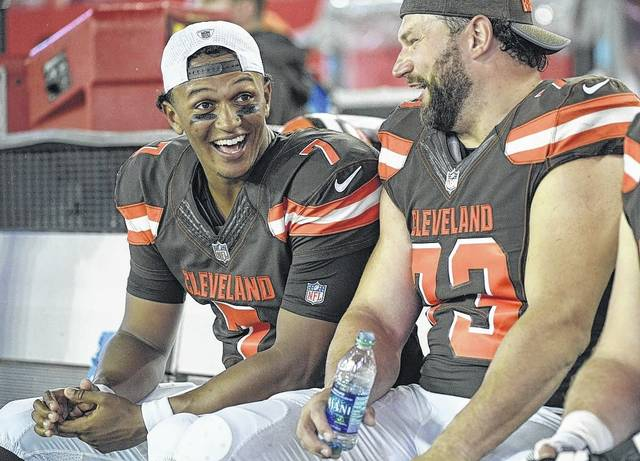 Cleveland Browns quarterback DeShone Kizer (7) talks with tackle Joe Thomas (73) during the second half of an NFL preseason football game against the Tampa Bay Buccaneers on Saturday night.