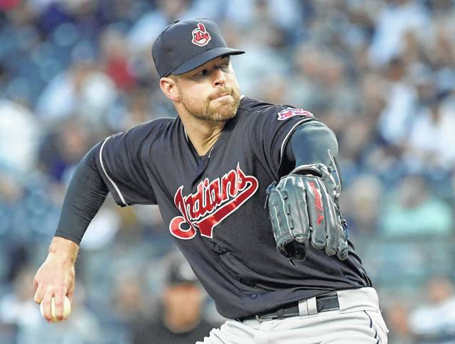 Cleveland Indians pitcher Corey Kluber delivers the ball to the New York Yankees during the first inning of a baseball game, Monday.)