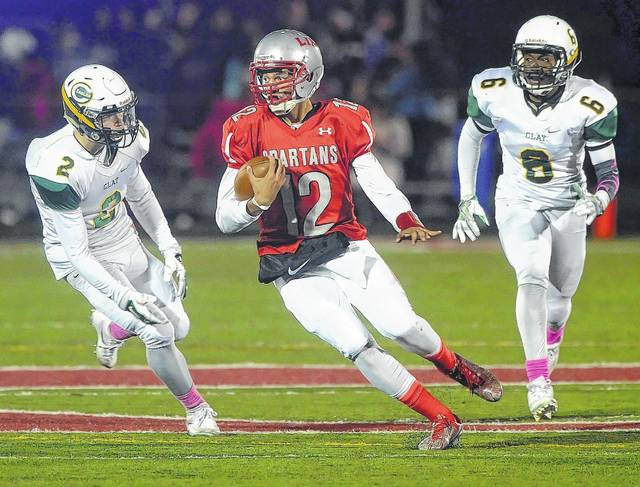 Lima Senior's Adrine Mitchell, shown here last year against Oregon Clay, had a big game for the Spartans in their season opener against Middletown, rushing and passing for more than 100 yards in each category. Mitchell also accounted for three touchdowns.