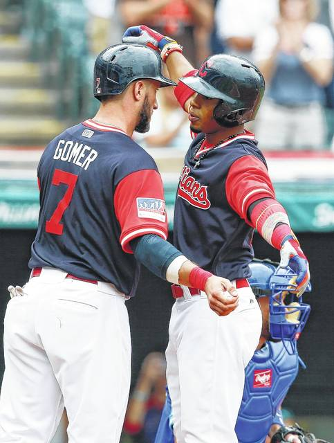 Cleveland Indians' Francisco Lindor celebrates with Yan Gomes (7) after hitting a two run home run off Kansas City Royals starting pitcher Eric Skoglund during the second inning in a baseball game, Sunday, Aug. 27, 2017, in Cleveland. (AP Photo/Ron Schwane)