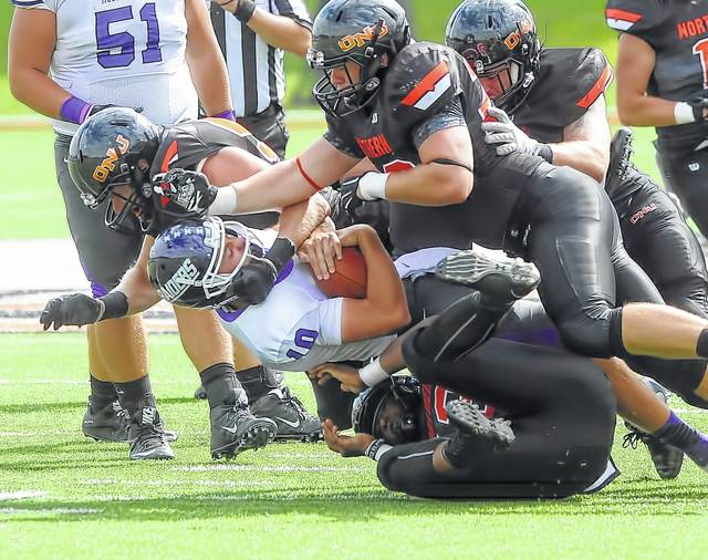 The Ohio Northern University defense returns three players on defense including Wapakoneta product Zach Schmerge shown here getting in on a tackle against Mount Union last year.