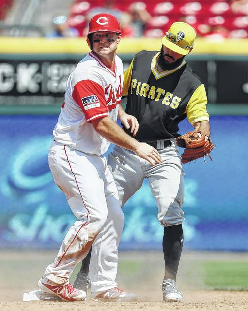 Pittsburgh Pirates shortstop Sean Rodriguez, right, catches Cincinnati Reds' Scott Schebler, left, stealing at second in the sixth inning of a baseball game, Sunday, Aug. 27, 2017, in Cincinnati. The Pirates won 5-2. (AP Photo/John Minchillo)