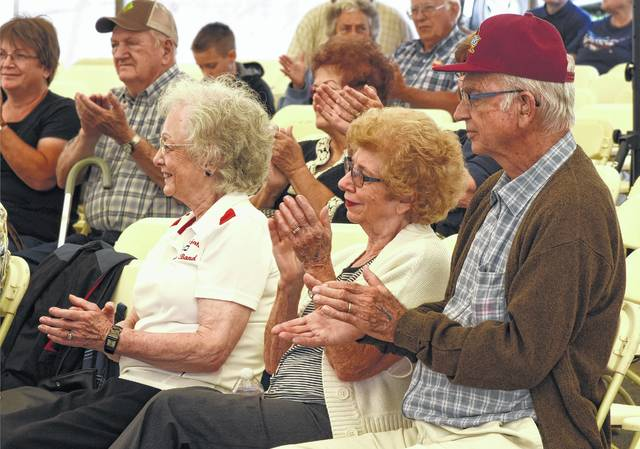 Joyce Brackut, left, with Margaret and Ross Bowsher, applaud the Hallelujah Saints Band performance during the Golden Age Day Party at the Allen County Fair on Thursday morning.