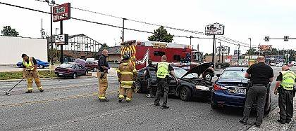 American Township EMT's and firefighters with Allen County Sheriff's deputies, attended to a three car accident southbound on Cable Road in front of Mark Pi's and O'Reilly Auto Parts on Monday afternoon.  Craig J. Orosz | The Lima News