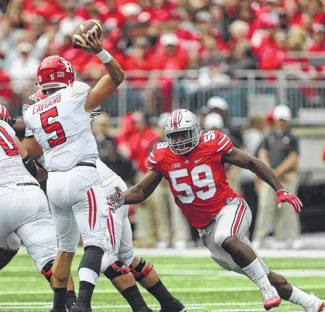 Ohio State defensive end Tyquan Lewis (59) prepares to hit Rutgers quarterback Chris Laviano during a game last season at Ohio Stadium.