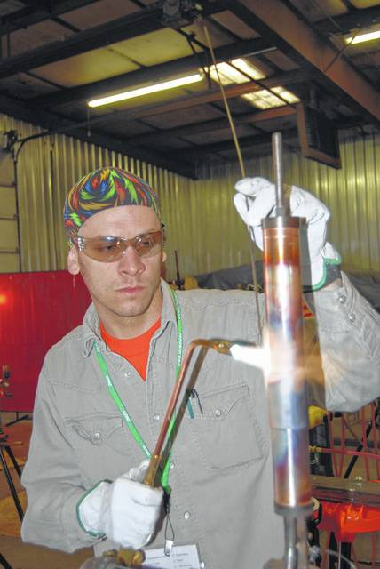 Matt Chiles, a member of the United Association of Plumbers, Pipefitters and Service Technicians, brazes a copper joint at the union's training center. The association helps train workers to advance in their careers.