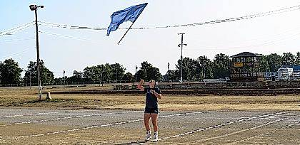 John Bush   The Lima News Lauren Criblez, a junior at Allen East High School, tosses her flag high in the air during the class B feature flags competition Saturday morning at the Allen County Fair. Criblez came in second place.