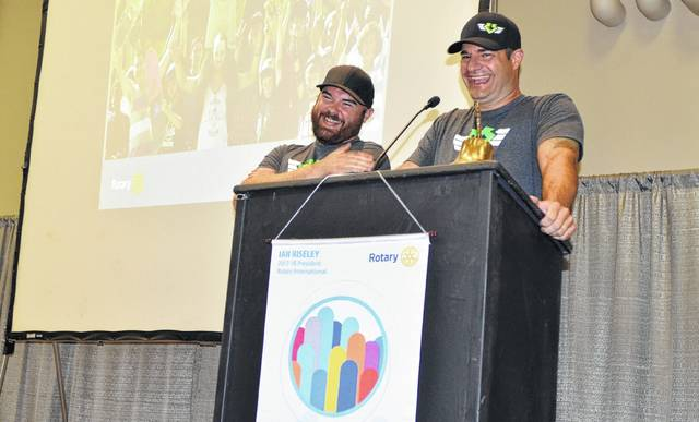 Matt Bowley and Don DiBartolomeo, co-founders of The Right Direction Youth Development Program, share a laugh with members of the Lima Rotary Club on Monday as they discuss their nonprofit organization, which uses action sports as a catalyst to teach life skills to youth.
