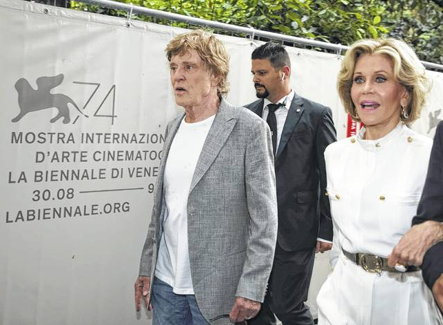 """Actors Robert Redford and Jane Fonda arrive for the press conference for the movie """"Our Souls At Night"""" at the 74th Venice Film Festival in Venice, Italy, on Friday."""