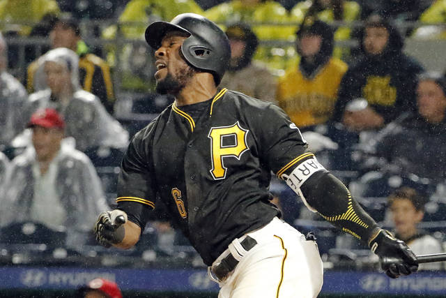 Pittsburgh Pirates' Starling Marte watches his RBI single off Cincinnati Reds relief pitcher Michael Lorenzen during the seventh inning of a baseball game in Pittsburgh, Saturday, Sept. 2, 2017. (AP Photo/Gene J. Puskar)