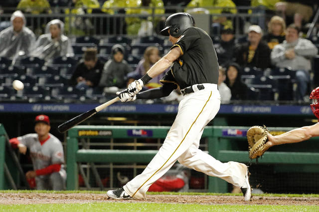 Pittsburgh Pirates' Jordan Luplow hits a three-run home run off Cincinnati Reds relief pitcher Wandy Peralta during the eighth inning of a baseball game in Pittsburgh, Saturday, Sept. 2, 2017. (AP Photo/Gene J. Puskar)