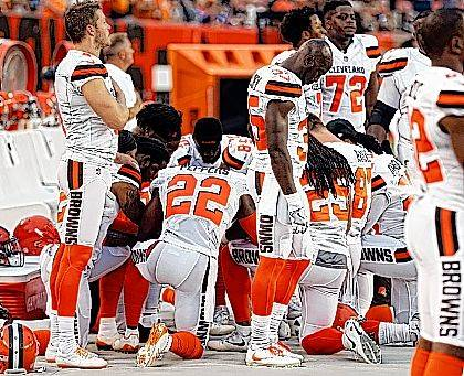 This Aug. 21 file photo shows members of the Cleveland Browns kneeling during the national anthem before an NFL preseason football game between the New York Giants and the Cleveland Browns in Cleveland. Unions representing Cleveland police and paramedics say they won't hold a large American flag before the Cleveland Browns' season opener because of previous player protests during the national anthem. The president of the Cleveland Association of Rescue Employees union Local 1975 said Saturday the protest has upset union members.