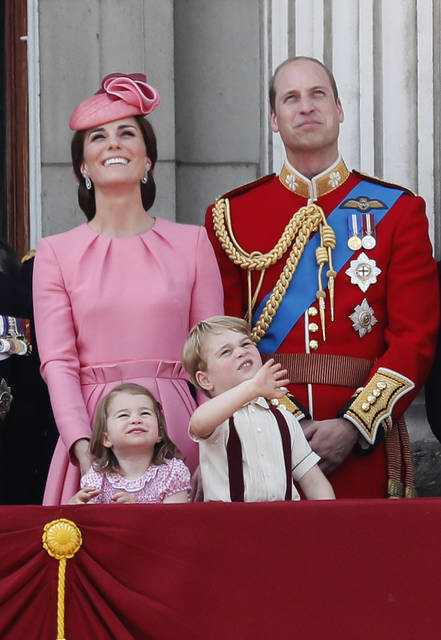 In this June 17 photo Britain's Kate, The Duchess of Cambridge, Prince William and their children Princess Charlotte and Prince George appear on the balcony of Buckingham Palace, after attending the annual Trooping the Colour Ceremony in London. Kensington Palace says Prince William and his wife are expecting their third child. The announcement released in a statement Monday says the queen is delighted by the news.