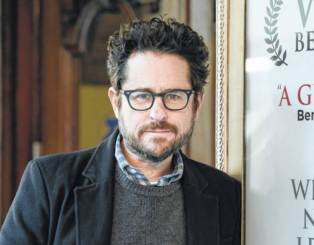 """In this March 2, 2017 file photo, director-producer J.J. Abrams poses for a portrait to promote """"The Play That Goes Wrong"""" at the Lyceum Theatre in New York. Abrams is returning to """"Star Wars"""" and will replace Colin Trevorrow as writer and director of """"Episode IX."""" Disney announced Abrams return on Tuesday."""