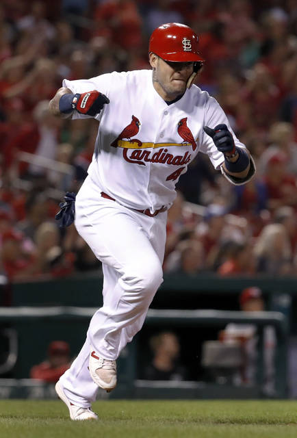 St. Louis Cardinals' Yadier Molina celebrates after hitting two-run double during the first inning of a baseball game against the Cincinnati Reds on Tuesday, Sept. 12, 2017, in St. Louis. (AP Photo/Jeff Roberson)