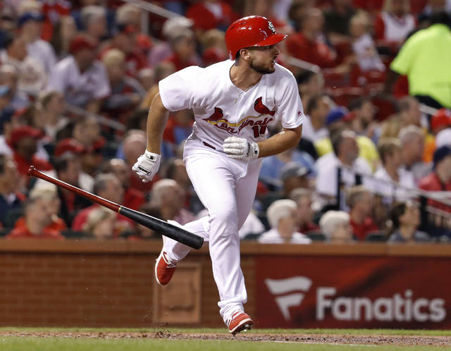 St. Louis Cardinals' Paul DeJong drops his bat as he watches his RBI double during the second inning of a baseball game against the Cincinnati Reds Tuesday, Sept. 12, 2017, in St. Louis. (AP Photo/Jeff Roberson)