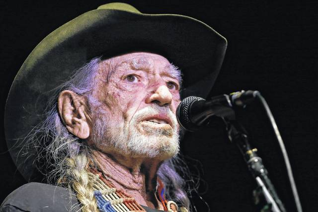 """Willie Nelson performs in Nashville, Tenn., in January. Organizers of the """"Harvey Can't Mess With Texas"""" benefit concert announced Wednesday that Nelson, Bonnie Raitt, Paul Simon and James Taylor are among the stars headlining the four-hour show scheduled for Sept. 22 in Austin that will raise money for victims of Hurricane Harvey."""