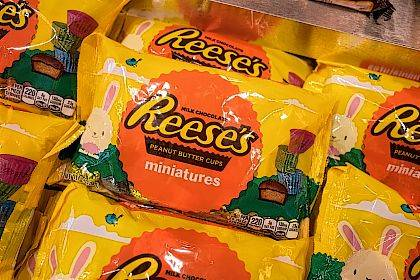 FILE - In this March 1, 2017, file photo, Reese's miniature peanut butter cups are displayed in Hershey's Times Square store in New York. Hershey's told the AP on Sept. 15, 2017, that a story claiming the company would discontinue the Reese's candy is false. (AP Photo/Mark Lennihan, File)