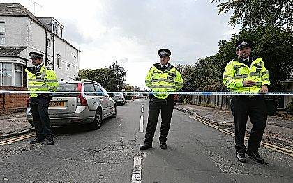 "Police officers secure a road in Sunbury-on-Thames, southwest London, as part of the investigation into Friday's Parsons Green bombing, Saturday Sept, 16, 2017.  British police made what they called a ""significant"" arrest Saturday in southern England, and searched a property in Sunbury-on-Thames as the manhunt for suspects continues following the partially exploded bomb attack on the London subway. ( Jonathan Brady/PA via AP)"