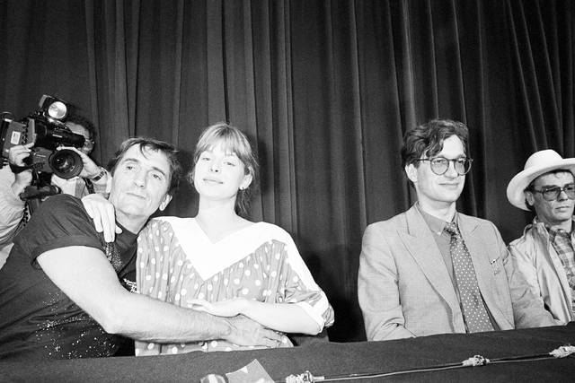 "FILE - In this May 19, 1984, file photo, American actor Harry Dean Stanton, left, and German actress, Nastassja Kinski embrace during a photo session at the 37th Cannes Film Festival. At right are film director Wim Wenders and actor Dean Stockwell. Wenders directed ""Paris, Texas,"" in which Stanton and Kinski starred. Legendary character actor Stanton has died at age 91. Stanton's agent John S. Kelly says the actor died of natural causes Friday afternoon, Sept. 15, 2017, at Cedars-Sinai Medical Center in Los Angeles.  (AP Photo/Michel Lipchitz, File)"