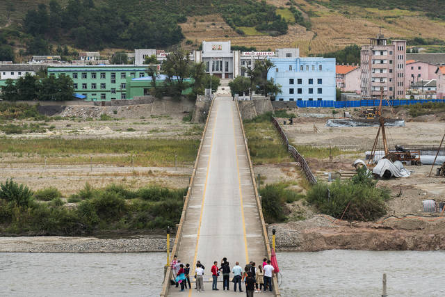 In this Sunday, Sept. 10, 2017, photo, Chinese tourists stand watch on Tumen bridge linking China and North Korea, as seen from Yanbian, Jilin province. U.S. Secretary of State Rex Tillerson on Friday, Sept. 15, 2017, calling on all nations to take new measures against Kim Jong Un's regime after North Korea's latest missile launch. (AP Photo)
