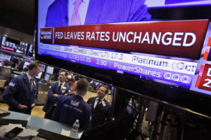 US stocks wobble after Fed announcement, but close higher