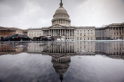 In this July 28 photo, the Capitol is seen during a heavy rain in Washington. Harvey has scrambled the equation for Congress as lawmakers return to Washington on Tuesday. Having accomplished little in the first six months of the year they now face a daunting workload, but the immediate need to send aid to help Texas and Louisiana recover from the massive storm damage takes center stage, and pushes other disputes to the side.