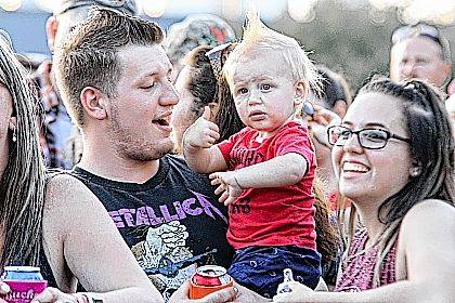 Richard, Aiden, 1, and Haley Tordiff enjoy live music and a great time at the Lima Harley-Davidson Bud Bash on Sunday.