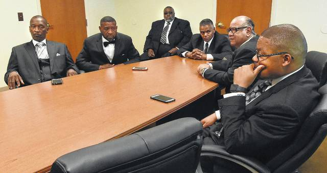 Dr. Frank Taylor speaks during the Lima Area Black Ministerial Alliance press conference held at Shiloh Missionary Baptist Church in Lima on Friday. Left to right, Pastor Arthor Butler, Pastor Arnold Manley, Pastor Nathan Madison, Pastor Cleven Jones, and far right, Dr. Lamont Monford.