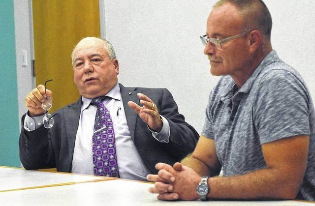 Ray Magnus, former city councilman, left, and Lima City Council 1st Ward Councilman Todd Gordon debate during an election forum at The Lima News on Wednesday.