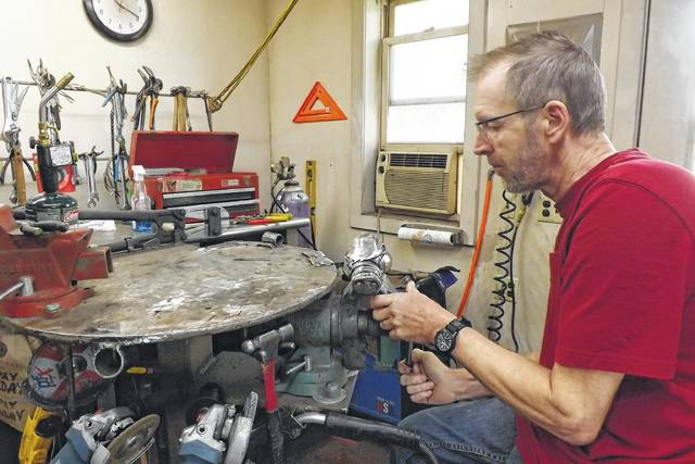In a small building behind Gary Hovey's rural New Knoxville home, you can find the artist working on his flatware sculptures on days when his health permits. He has participated in numerous solo and group exhibitions.