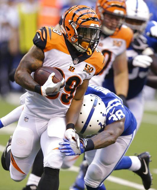 Cincinnati Bengals running back Jarveon Williams, left, runs with the ball as Indianapolis Colts defensive back Corey White (38) defends during the first half of an NFL preseason football game in Indianapolis, Thursday, Aug. 31, 2017. AP Photo/Michael Conroy)