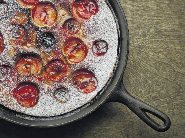 This Aug. 17, 2017 photo provided by The Culinary Institute of America shows a plum clafoutis in Hyde Park, N.Y. This dish is from a recipe by the CIA.